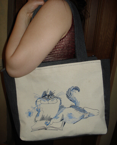 small embroidered bag with funny cat design
