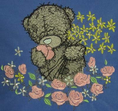 Tatty teddy with sea of flowers machine embroidery collection